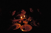 Burmese family eating