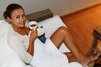 38 year old woman taking a cup of tea