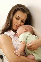 Mother holding her sleeping baby son (thumbnail)