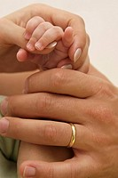 Hands of happy family - parents and baby (thumbnail)