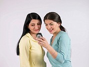 Two women looking at mobile phone (thumbnail)