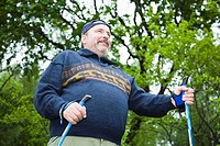 Middle-aged man doing nordic walking  Exercise  Finland