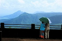 Mauritius, couple enjoying a scenic view on the mountains