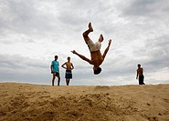 Young man jumping on the beach. Tangier. Morocco