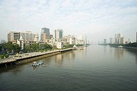China, Guangdong Province, Guangzhou, cityscape seen from water