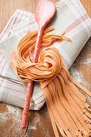 Home-made orange ribbon pasta