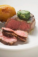 Beef steak with herb butter and baked potato