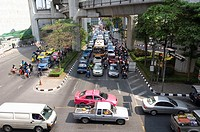 Morning Traffic on Phaya Thai Road opposite the MBK Center, Bangkok. Thailand