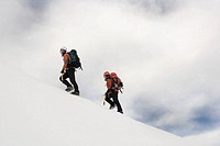 Mountaineer climbing Snowy Mountain