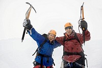 Enthusiastic mountaineers in Snowy Mountain with ice axes