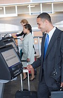 Man using express check-in service at airport