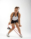 Young woman struggling exercise band