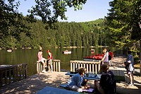 Tourists, on, board, walk, pedal, boats, on, Mummelsee, below, Hornisgrinde, Seebach, Black, Forest, Baden-Wurttemberg, Germany,