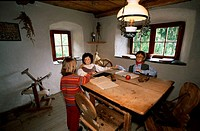 Child, with, Heidi, and, Peter, figures, in, living, room, in, the, Heidi, museum, Heidi´s, village, Graubunden, Switzerland