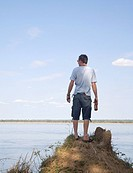 Young Man Standing on an Anthill Overlooking the Zambezi River  Southern Province, Zambia