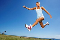 Portrait of a Female Athlete Jumping  Cape Town, Western Cape Province, South Africa