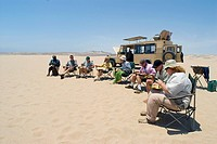 Tourists Eating on a Desert Safari  Hoarusib River Valley, Skeleton Coast National Park, Kaokoland, Namibia, Africa