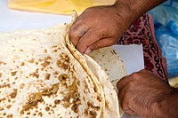 Hand preparing pita in bakery, Deira, UAE  United Arab Emirates