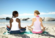 African Woman and a Caucasian Woman Exercising on the Beach  Cape Town, Western Cape Province, South Africa