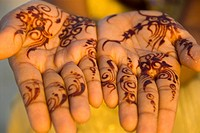 Woman Showing off her Hands with Detailed Design in Henna  Jumeria, Dubai, United Arab Emirates