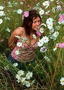 High Angle View of a Woman in a Cosmos Field Smelling the Flowers  Standerton, Mpumalamga Province, South Africa