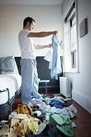 Man holding pajamas