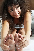 Woman touching toes (thumbnail)