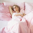Woman lying in bed alone