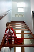 Boy sitting on stairway