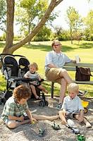 Father sitting near children