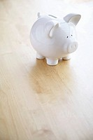 Piggy bank on wood floor