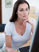 Woman with eyeglasses at computer