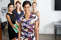 Group of businesswomen in an office smiling