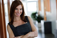 Businesswoman standing in office smiling