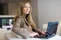 Businesswoman with mini_laptop computer