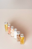 A row of six pill bottles