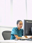 Businesswoman sitting at a computer in an office