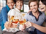 Four people toasting with champagne flutes