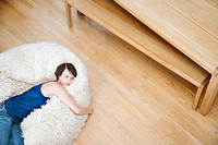 Woman on a furry bean bag chair