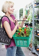 Woman with plants in shopping basket