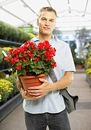 Man holding potted plant