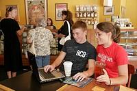Chocolate Cafe, teen couple, laptop computer, wireless access. Michigan Street. South Bend. Indiana. USA.