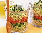 Layered couscous, courgette and tomato salad