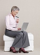 Senior adult with laptop and credit card