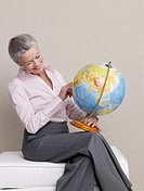 Senior adult with a globe