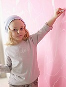 Blond girl wearing a headscarf is painting (thumbnail)
