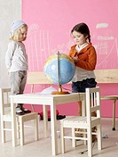 Two girls with a globe (thumbnail)