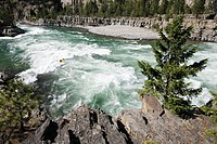 Kootenai Falls  Canoeist negotiating rapids at Kootenai Falls, on the Kootenai River, Montana, USA  This is the last major waterfall in northwest USA ...