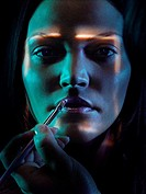 Face recognition and make-up application  Conceptual image of a biometric security system represented by a woman´s face being scanned