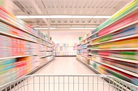 Supermarket trolley being pushed up aisle, blurred motion